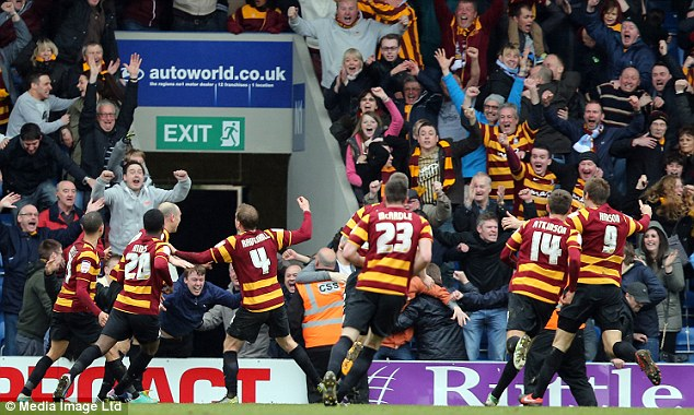Crowd delight: Ricky Ravenhill celebrates after scoring for Bradford