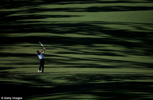 Out in front: Jason Day of Australia hits a shot on the 10th hole