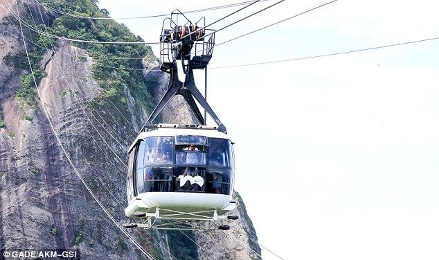 Quite a view: The car is suspended by reams of cables as glides along
