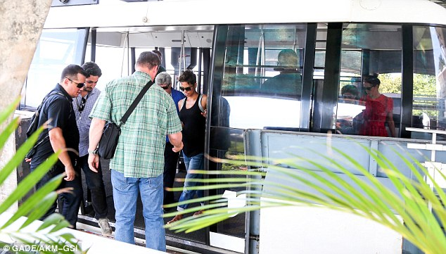 Stepping out: Halle was spotted climbing out of the cablecar after the ride