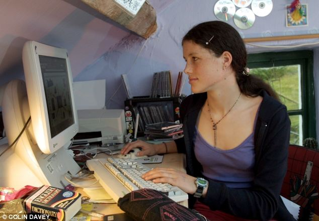 Josie Russell with her computer at her home in North Wales in 2001