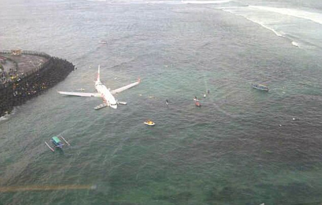 Scary: The plane skidded off the runway and landed in shallow water. Passengers made their way back to shore in yellow dinghies