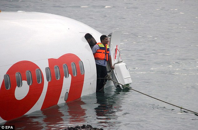 Brave: A rescue worker looks out from the cockpit during a search for passengers