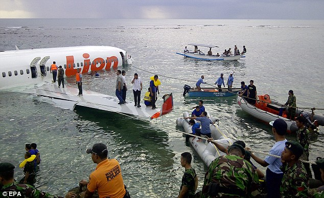 Dramatic: Rescue workers used dinghies and ropes to help the passengers onboard the plane