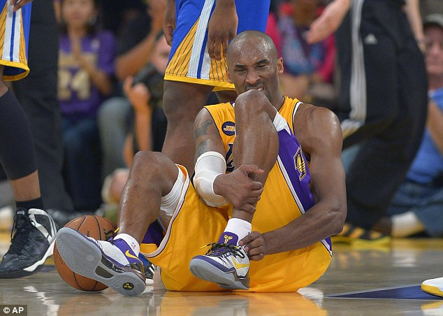 Down: Los Angeles Lakers guard Kobe Bryant grimaces in pain after injuring his left Achilles tendon during the second half of their NBA basketball game against the Golden State Warriors on Friday