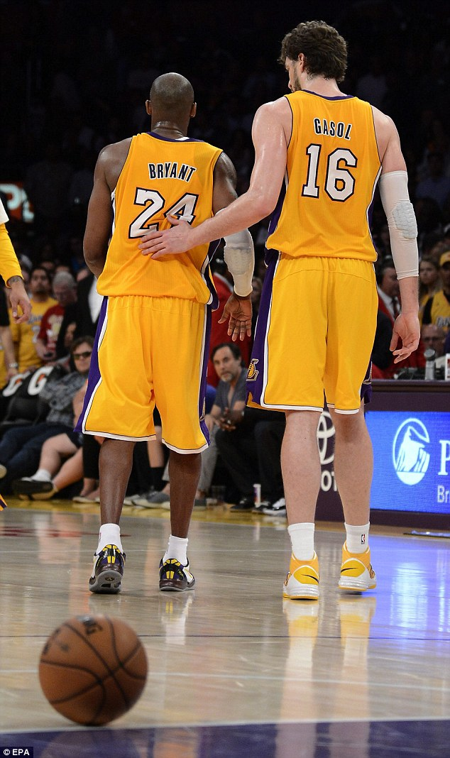 Comforted: Teammate Pau Gasol comforts Bryant as they head court side together after his traumatic injury