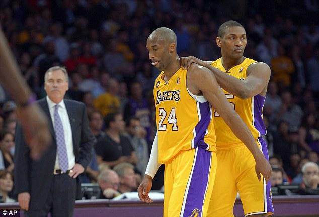 Hopeful: Lakers forward Metta World Peace, right rubs Kobe's shoulders as head coach Mike D'Antoni looks on