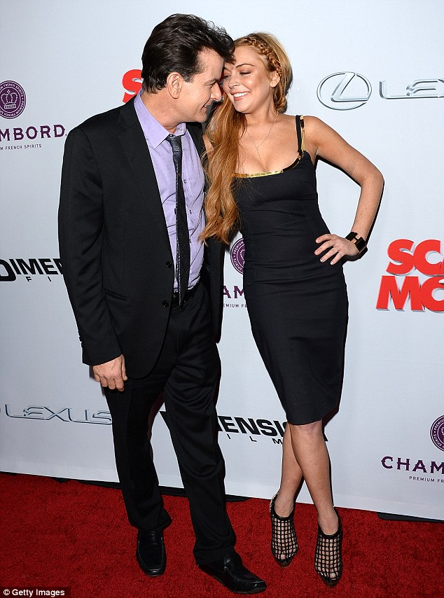 Flirty: The red-haired star got a warm welcome from Charlie Sheen at Thursday night's Scary Movie 5 premiere in Hollywood