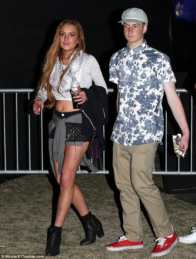 The minder: Lindsay Lohan looked rearing to go as she attended Coachella Music Festival 2013 with 16-year-old brother Cody, who hopefully will help steer his fiery sibling away from temptation before rehab
