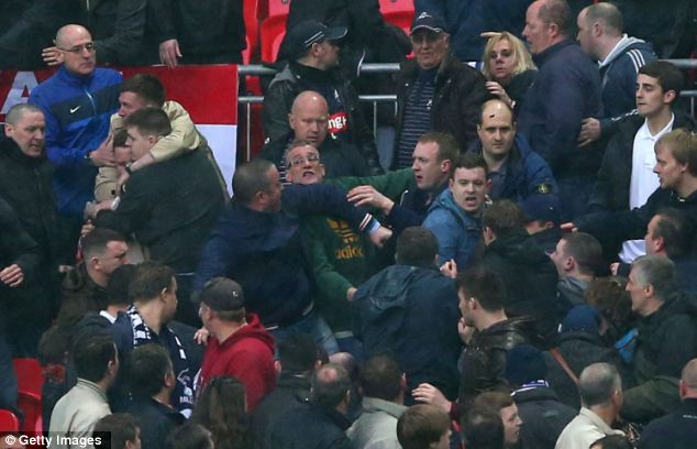 Bad end: Many fans looked horrified as rows erupted in the stands after the disappointing match for Millwall