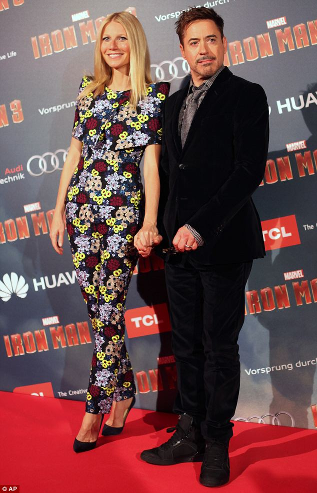 Funny face: Robert pulled an amusing face while Gwyneth gave her most dazzling smile
