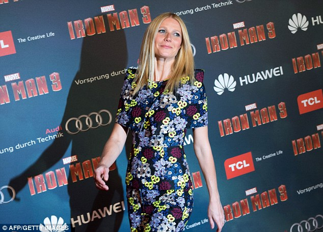 Poker straight: Gwyneth kept her hair simple not to detract from the bright outfit