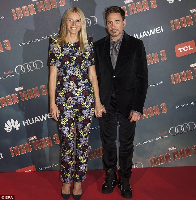 Getting on well: Gwyneth Paltrow and Robert Downey Jr show how close they are at Paris premiere of Iron Man 3 on Sunday