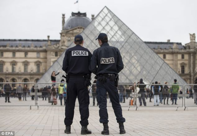 Guard: Officers at the Louvre, one of a number of attractions in Paris where security has been tightened