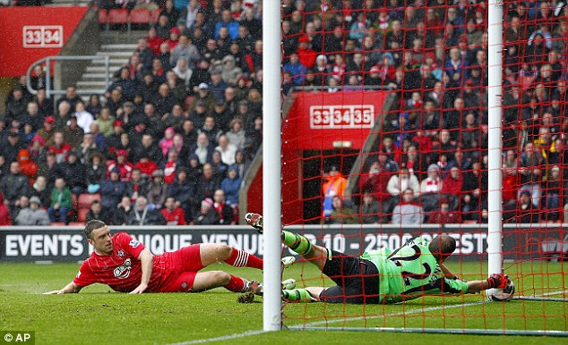 Battle: Andy Carroll hit the net but Rickie Lambert (below) was out of luck for Southampton