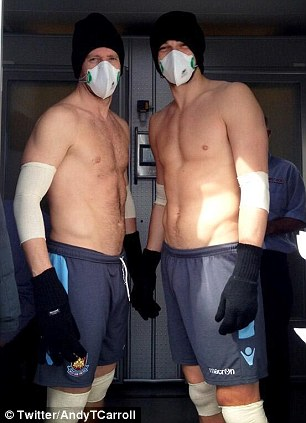 Ice cool: Kevin Nolan (left) and Andy Carroll in the ice chamber