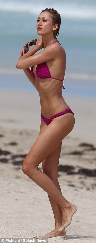 Think pink: The leggy blonde turned heads  on the beach in Miami with her pink thong bikini on Thursday