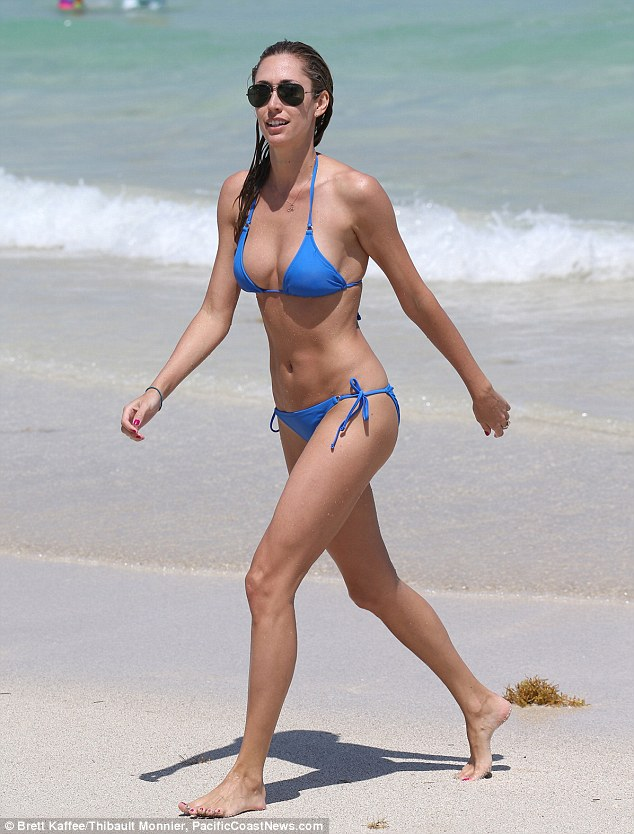 Beauty on the beach: Lauren Stoner was a vision in her blue string bikini as she enjoyed another day of sun and surf in Miami's South Beach, Florida