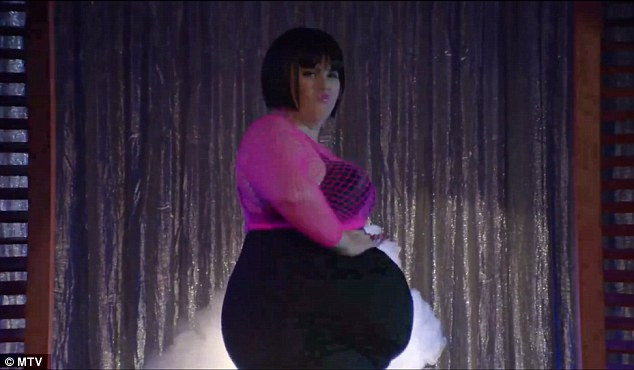 Poking fun: Rebel Wilson performs a striptease before giving birth in a new Magic Mike spoof for the MTV Movie Awards airing on Sunday