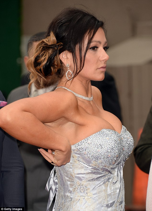 Forget overkill, this is overspill: J-Woww tries to go classy in a floor-length gown - which shows off her impressive cleavage