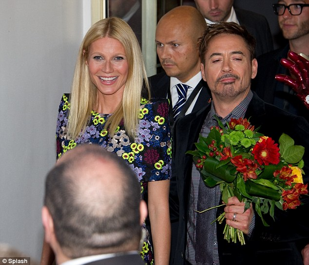 Fooling around: Robert was seen carrying a bunch of flowers and pulling a funny face as he walked with his co-star