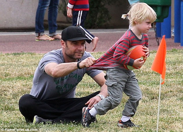 Making a dash for it: Liev had to keep a tight hold on his son Sam