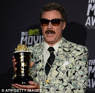Moneyman, funnyman? Will Ferrell wore a dollar-covered suit as he accepted the award for Comic Genius