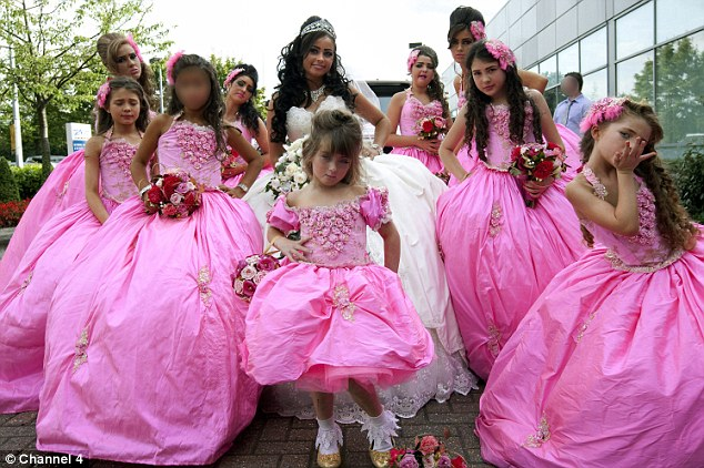 Team effort: Bride Margaret and her pink bridesmaids in My Big Fat Gypsy Fortune on Channel 4 last night