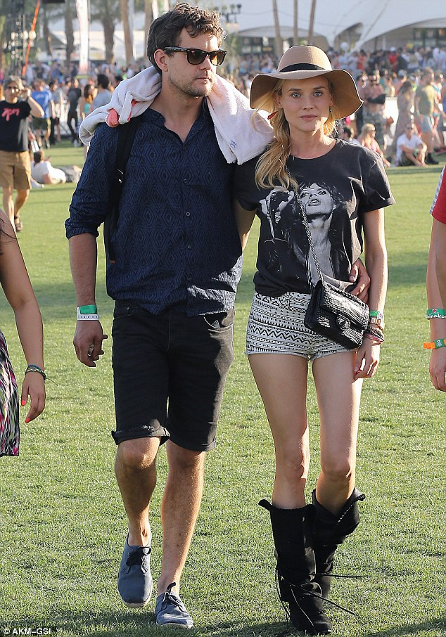 Born to roam: The pair, linked since 2006, wandered the festival grounds arm-in-arm earlier in the day