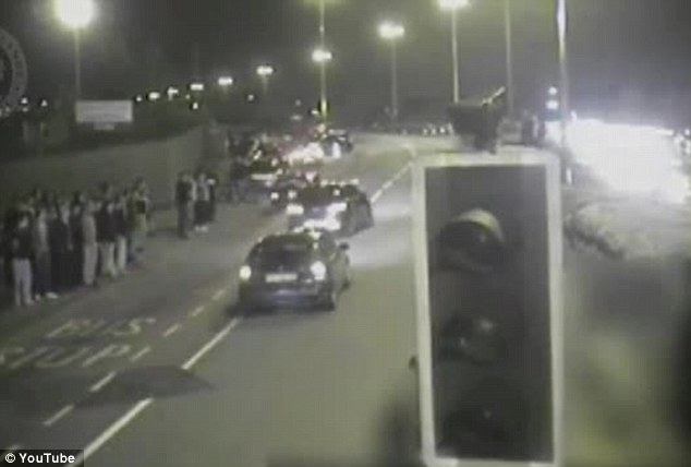 'Outrageous and illegal': The CCTV footage shows a crowd that gathered to watch the late-night drag racing along the A47 in Birmingham