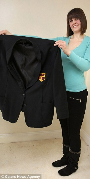 No longer fits: As a size 32 school girl, she had to have a specially-made uniform