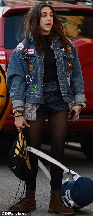 Stylish: Lourdes wore a denim jacket over denim shorts, tights and boots earlier in the day