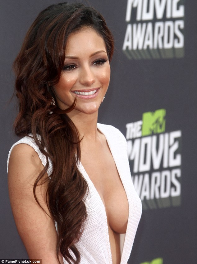 Giving J-Woww a run for their money! Melanie Iglesias takes the plunge in the knitted white dress