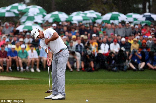 What a moment: Adam Scott's birdie putt on the 18th on Sunday looked to have won him the Masters