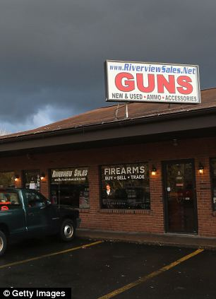 A customer approaches the closed Riverview Gun Sales shop on December 21, 2012 in East Windsor, Connecticut