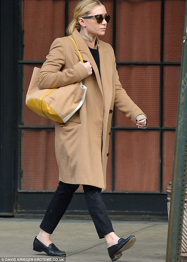 Chic but unflattering: There's no denying the fact that Ashley Olsen's outfit on Monday was chic, but the oversized coat somewhat swamped her