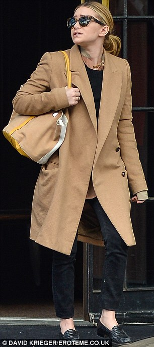Trendster: Olsen is up to date with the masculine fashion craze but it swamps her tiny figure