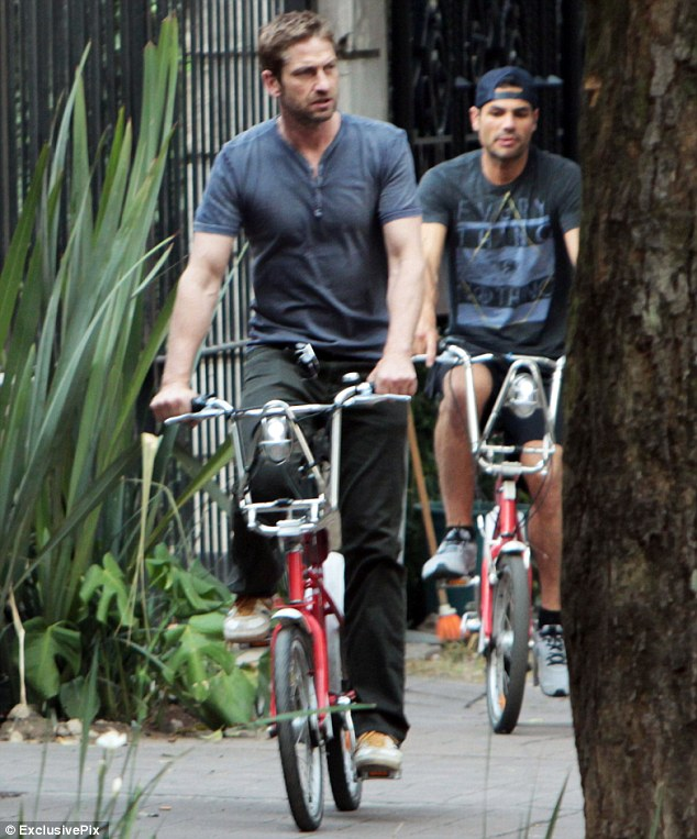 Bike time: Taking a break from promoting his film Olympus Has Fallen, Gerard Butler was seen cycling around Mexico City, Mexico on Tuesday