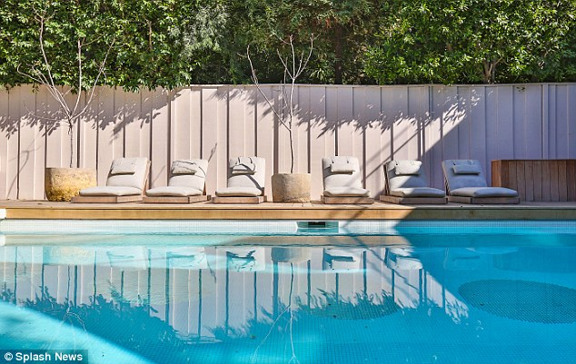 Sun trap: Loungers surrounded the pool with sparkling blue water