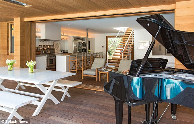 Play while you paddle: A baby grand piano sits on the poolside terrace