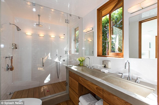 Light and bright: Another bathroom features a huge shower cubicle and lots of windows