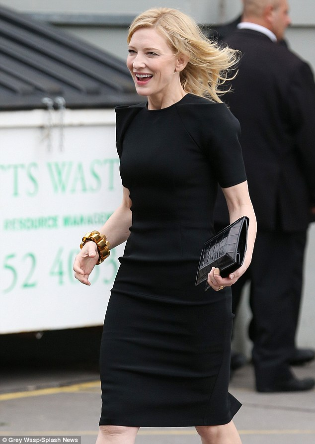 Smiling star: Cate wore minimal make-up on her porcelain complexion