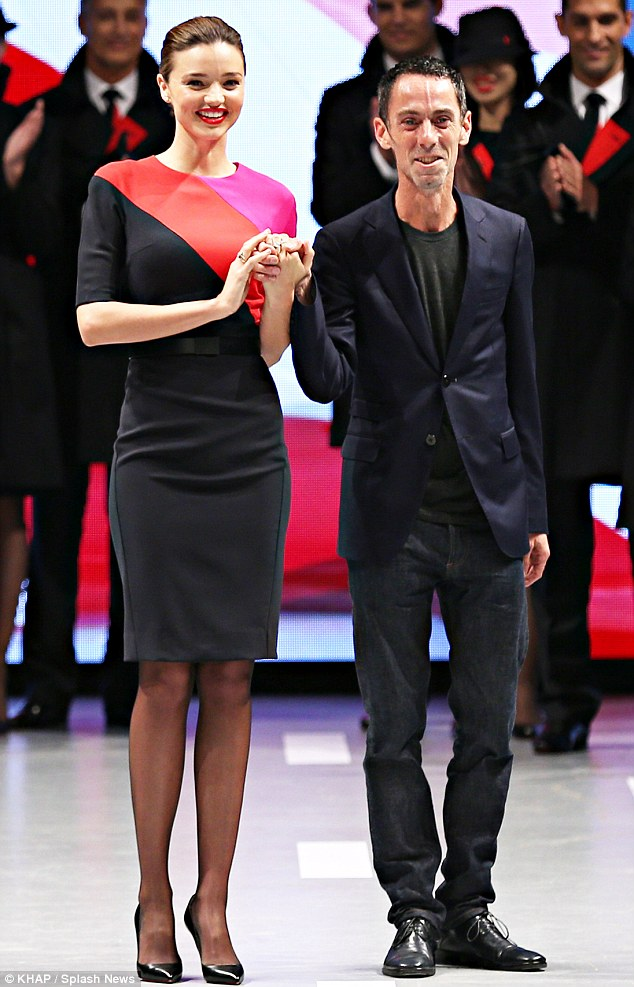 Round of applause: Miranda and designer of the new uniforms, Martin Grant, held hands at the end of the runway show