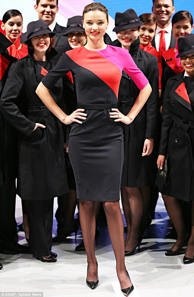 Still a hit on the runway: Miranda Kerr unveiled the new Qantas airline flight attendant uniforms on Tuesday in her native Australia