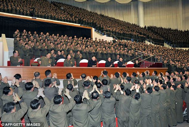 But all the applause was reserved for 'dear leader': Kim laps up the adulation on the North's national holiday