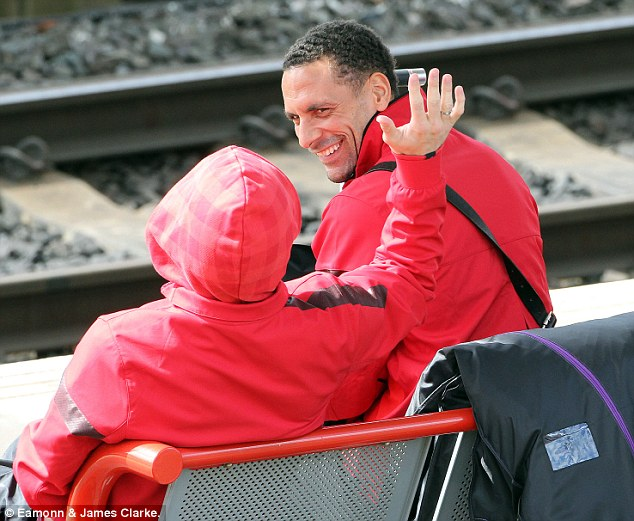 Nearly there: Rio Ferdinand looked up for a laugh as United power towards the Premier League title