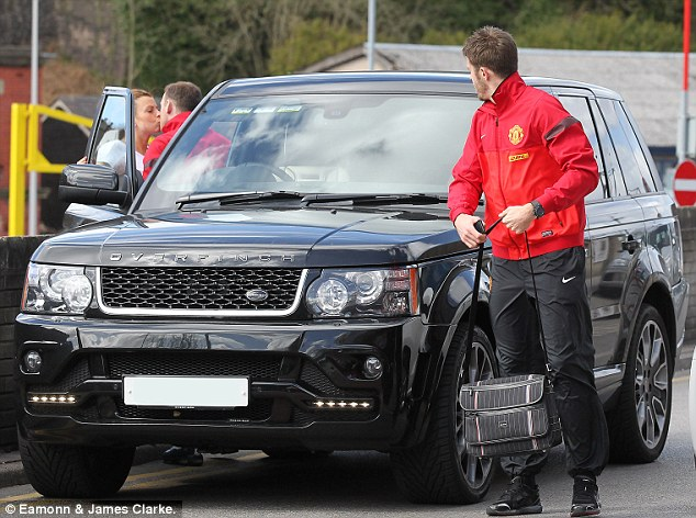 Get a room: Midfielder Michael Carrick watches the Rooneys' public display of affection