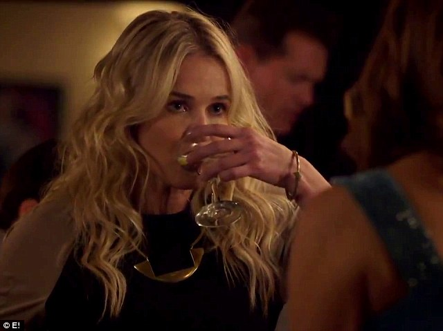 Drinking up: Chelsea Handler knocks back a stiff one as she deals with dinner with the Kardashians