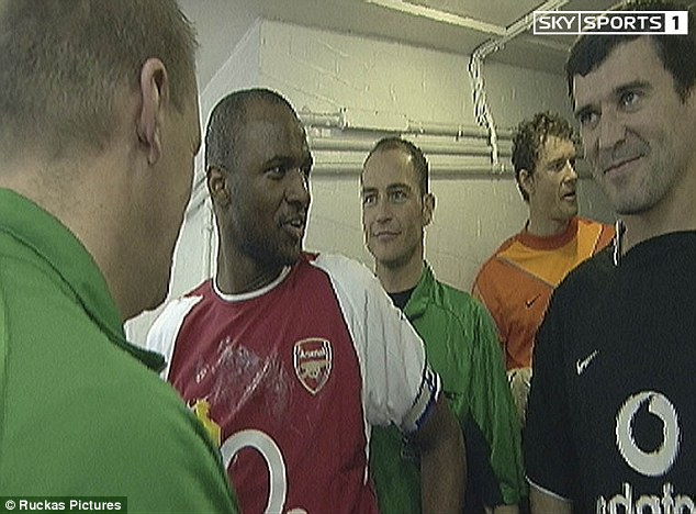 Malice aforethought: Patrick Vieira (left) heads for Roy Keane at Highbury, before the intervention of Graham Poll (below)