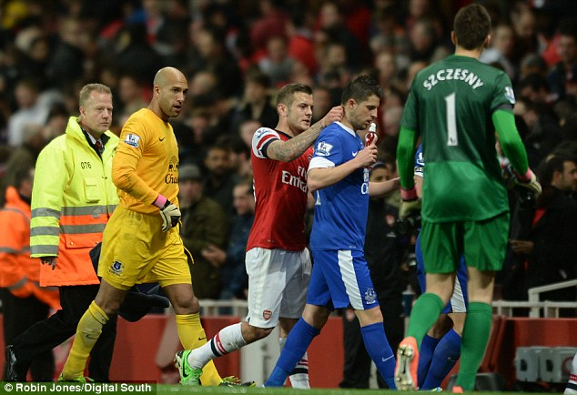 Gunning for you: Jack Wilshere was understandably furious with Kevin Mirallas as they left the pitch